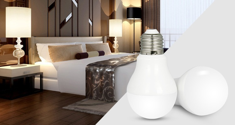 two white LED bulbs with E27 base in the bedroom next to bed side lamps